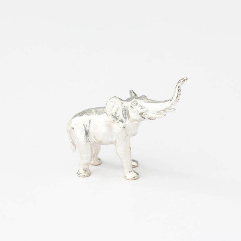 a small silver elephant ornament all british made