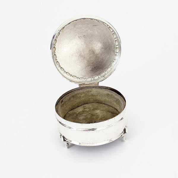 secondhand silver box round in shape and velvet inside