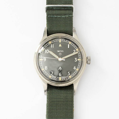 an english smiths mens mechanical military vintage watch with luminous dial and green fabric strap