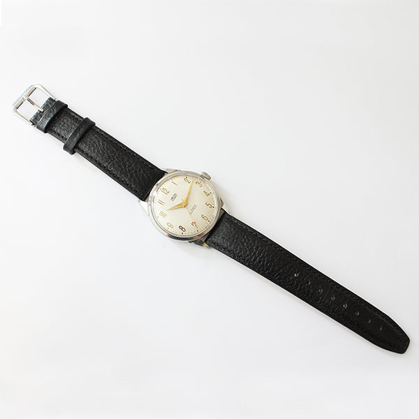 a superb vintage smiths mens watch withe steel case and black leather strap and 19 jewels