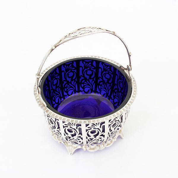 silver swing basket with blue liner in glass