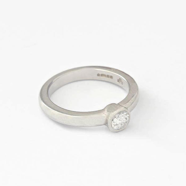 a modern secondhand diamond solitaire ring in a chunky mount in platinum