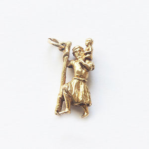 a yellow gold vintage saint Christopher yellow gold charm  Edit alt text