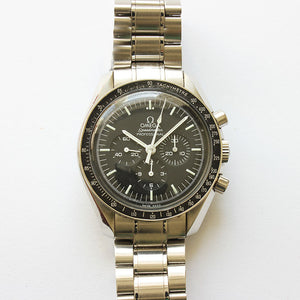 a vintage omega speed-master professional moon watch with steel case and box and papers dated 2013