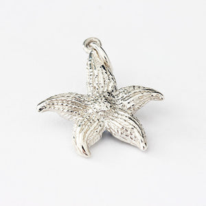silver starfish charm with pattern