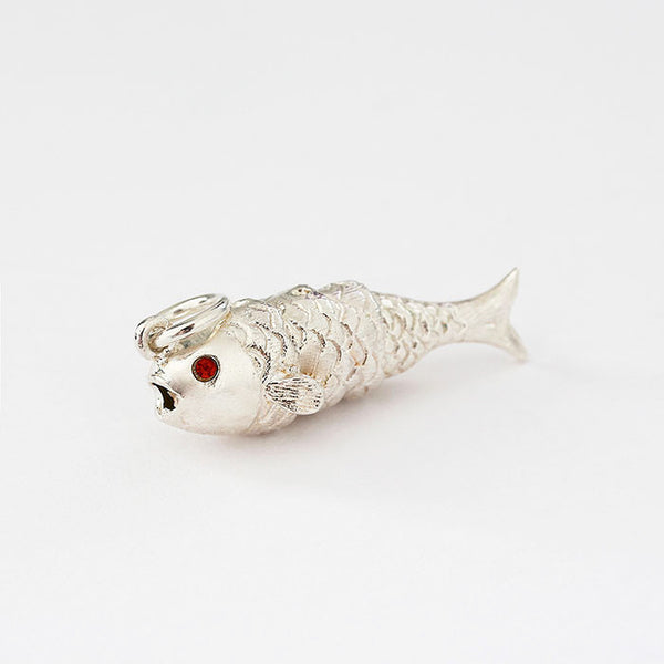 silver moving fish charm with red stone set eyes