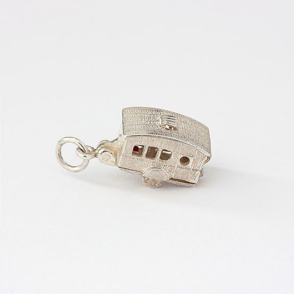 silver opening caravan charm with enamel and furniture inside