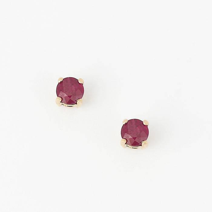 round faceted ruby stud earrings with 4 claw setting and all made 18ct yellow gold
