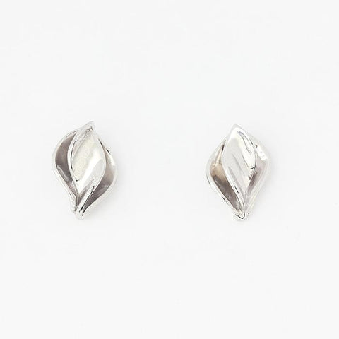 a silver set of stud earrings with a double layer leaf pattern all polished