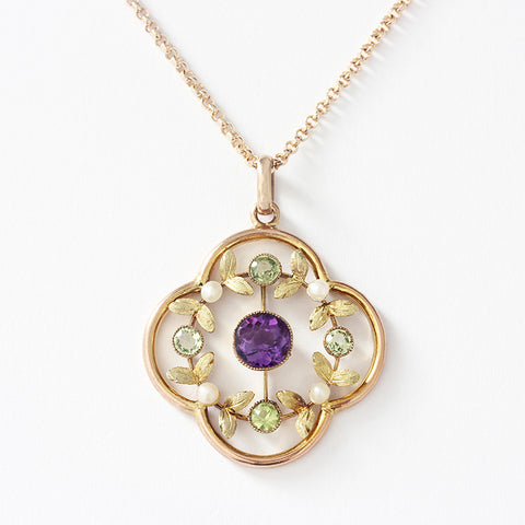 a suffragette amethyst and peridot and pearl floral design pendant with fine trace necklace