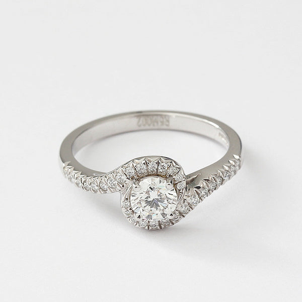 diamond crossover engagement ring in platinum with diamond shoulders
