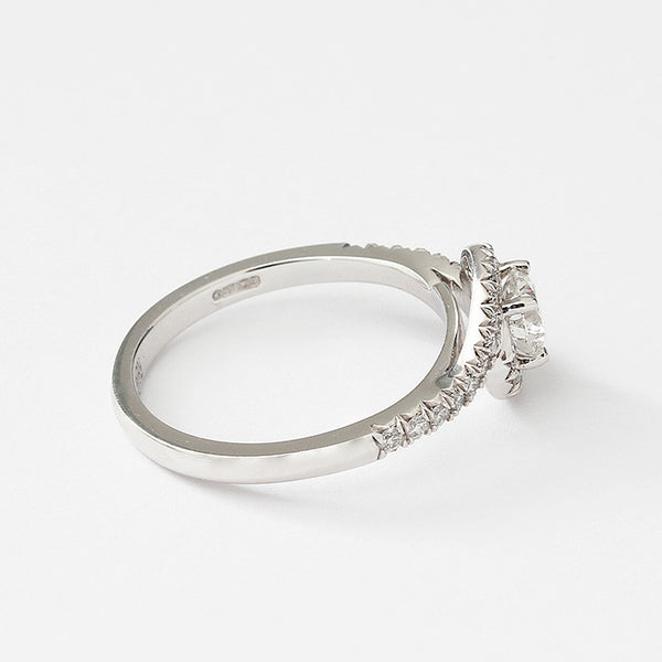 diamond crossover ring in platinum with diamond shoulders and claw setting