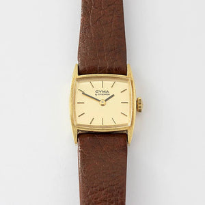 CYMA ladies tv shaped gold cased watch with a brown leather strap and original tag