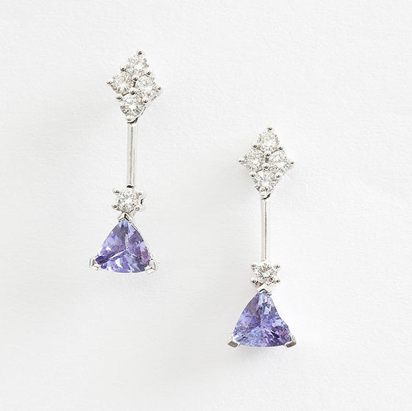 tanzanite and diamond drop earrings in white gold