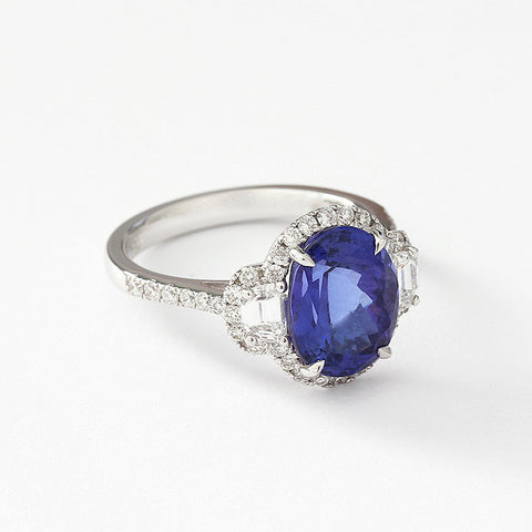 a tanzanite and diamond modern cluster ring in 18ct white gold and diamond shoulders