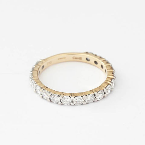 a three quarter diamond set eternity ring in yellow gold with claw settings and stamped Cavill inside