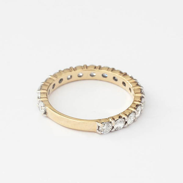 a secondhand yellow gold diamond set eternity ring three quarters the way round in a claw setting