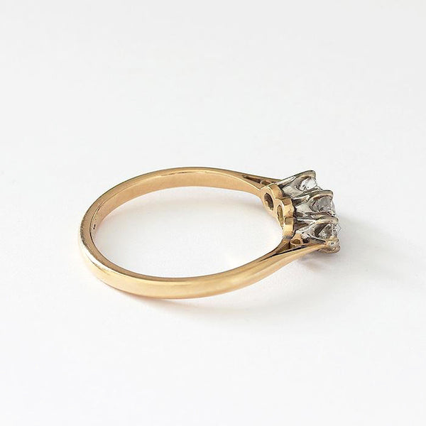 a vintage secondhand diamond 3 stone ring with claw settings and yellow band