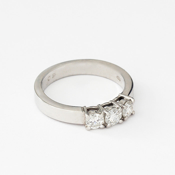 a diamond 3 stone engagement ring set in platinum and a claw setting