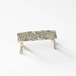 a tiny sterling silver vintage dolls house table with a floral pattern hallmarked birmingham 1984