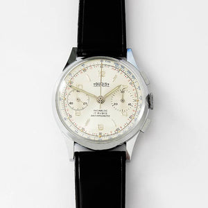 a vintage mens tourist wrist watch with original labels and strap incabloc movement 17 jewels