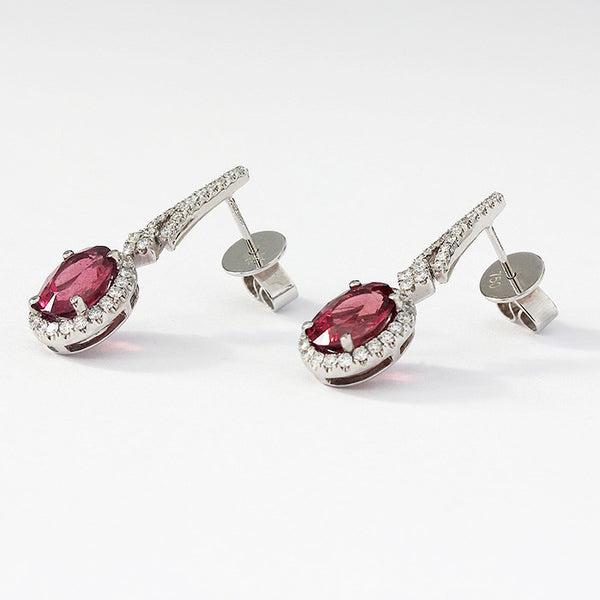 white gold drop earrings with diamonds and an oval pink tourmaline cluster design