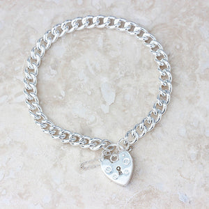 silver charm bracelet with padlock and safety chain