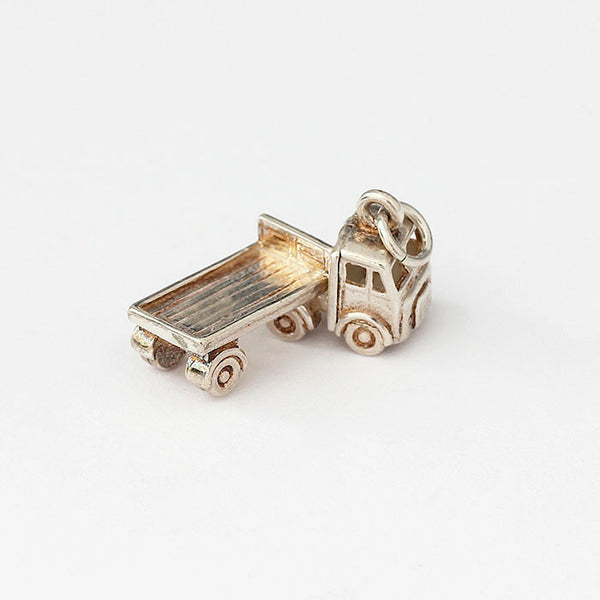 sterling silver truck charm which moves around on hinge