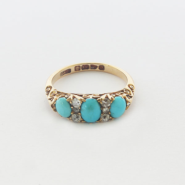a victorian yellow gold ring with turquoise and diamonds