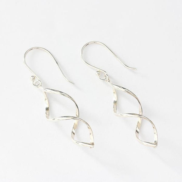 a double twisted set of silver earrings with a 3d effect and a hook fitting