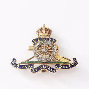 a diamond set and enamel royal artillery gold brooch with 18 carat yellow gold back