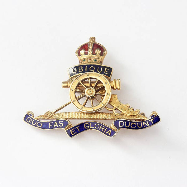 a royal artillery ww1 and ww2 brooch with red and blue enamel and 9 carat gold back