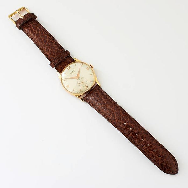 a secondhand preowned universal gents watch with 18ct rose gold case and brown leather strap with 33mm dial