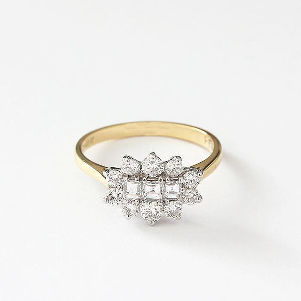 a secondhand diamond cluster ring with 3 square stones and 10 surround in gold