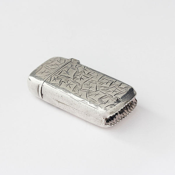 a silver victorian vesta case with ivy leaf pattern