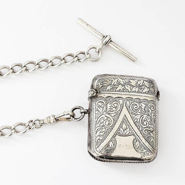 an antique vesta case dated 1903 in sterling silver with option for silver watch albert dated 1872