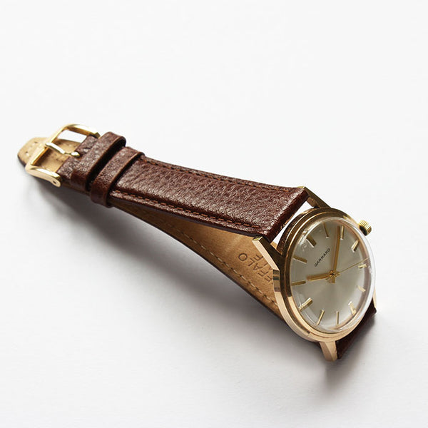a fine quality vintage garrard mens gold watch with brown leather strap excellent quality dated 1979