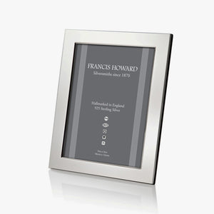 sterling silver photo frame made in sheffield with a wide plain finish and black wooden effect on the back