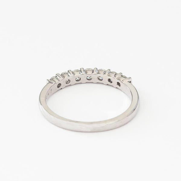 a white gold 7 stone diamond ring with round stones in a bar tension setting