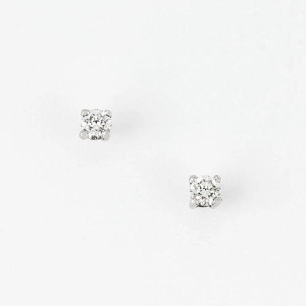 a diamond set of single stone stud earrings in white gold