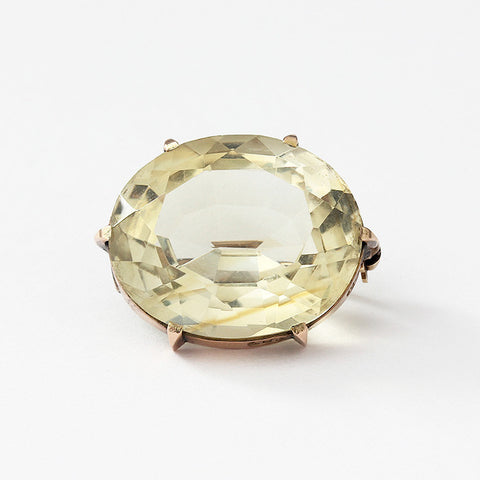 a light yellow citrine brooch with a 6 claw setting in yellow gold secondhand