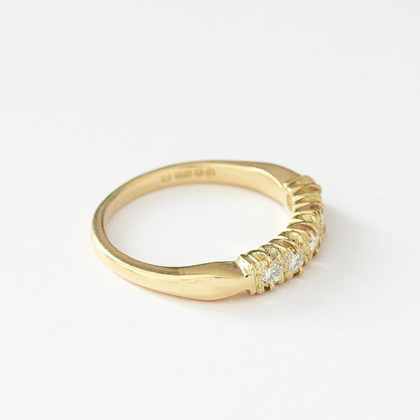 a vintage 18ct yellow gold diamond set half eternity ring with claw settings