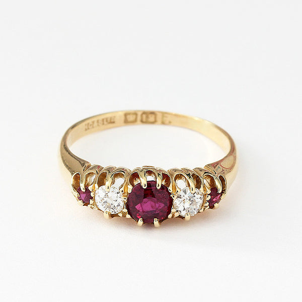 a claw set ruby and diamond 5 stone antique ring in yellow gold size N
