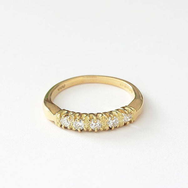 an 18ct yellow gold vintage diamond set half eternity ring with claw settings and 5 stones