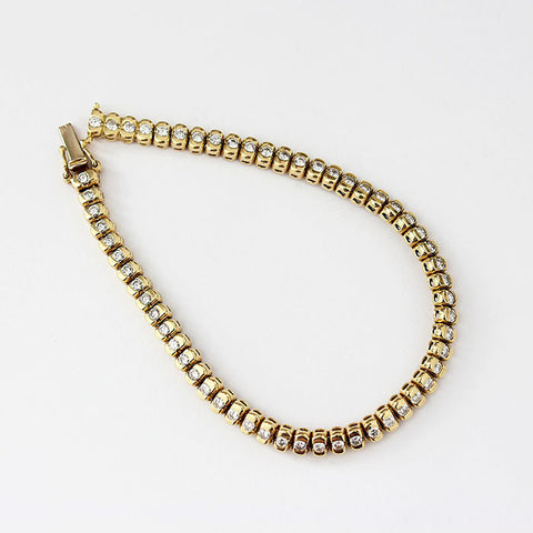 diamond set yellow gold bracelet 18ct rub over set round stones