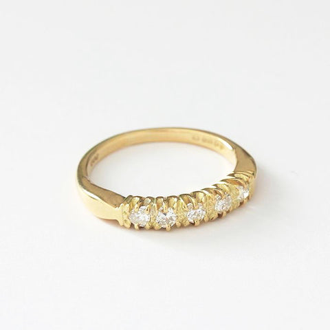 a preowned diamond set half eternity vintage style ring in yellow gold