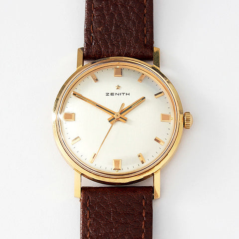 a vintage zenith mens watch with rose gold case and leather strap with box