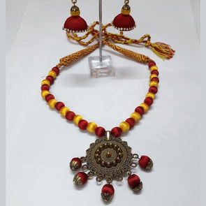 Silk Thread with Antique Gold Pendant