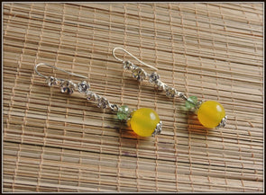 Yellow and green beads in silver hook style earrings