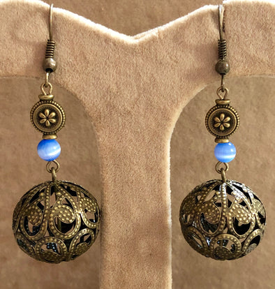 Antique Bronze Globe with Blue Cat's Eye Bead